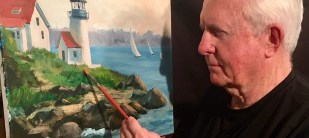 Artist painting a picture of a lighthouse