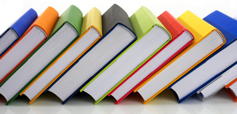 Colorful books, spine up, leaning to the right