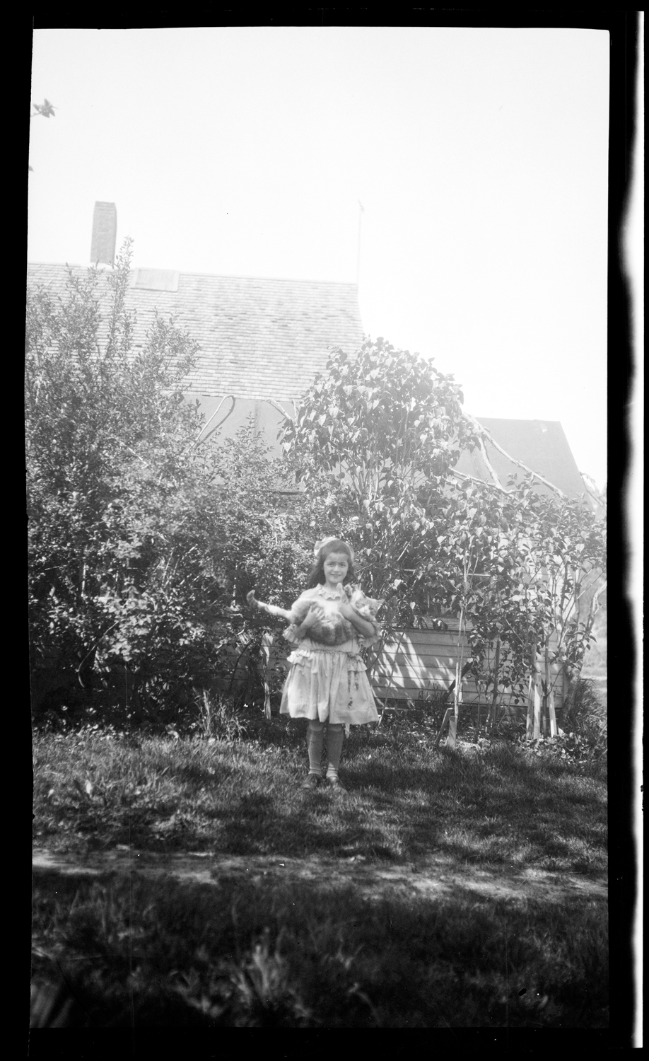 Norma Drew holding a cat, around 1925