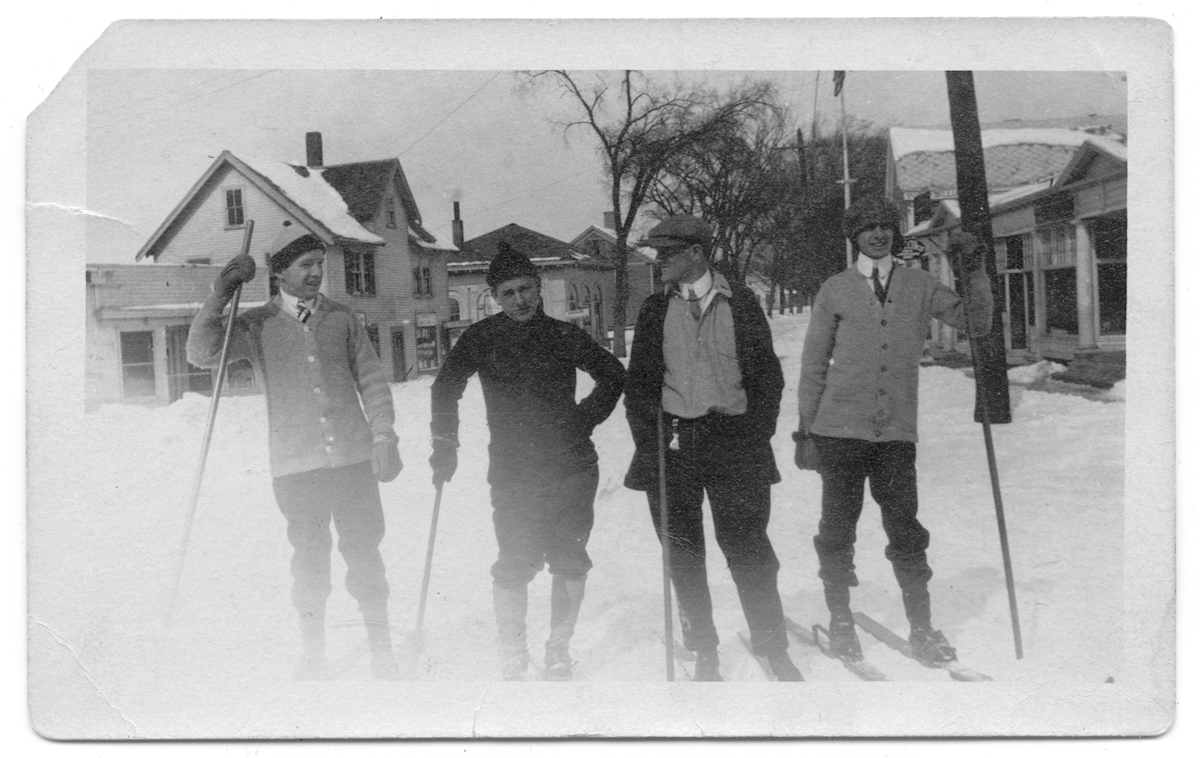 Four young men on cross-country skis on Summer Street in Kingston, MA