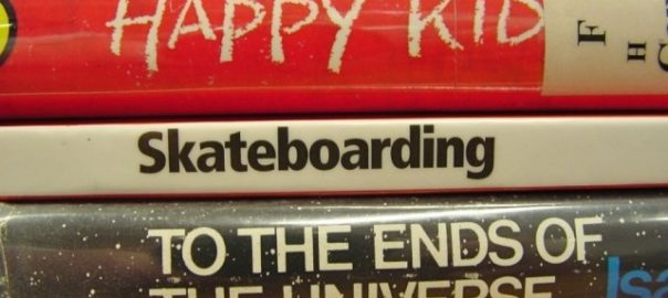 """Bookspine poem """"Happy Kid, Skateboarding, To the Ends of the Universe"""""""