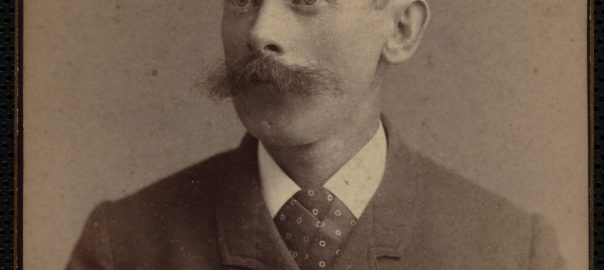 Black and white photo of a middle aged man with mustache