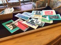 Artistic postcards in a display case