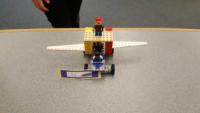 A LEGO plane with two pilots and landing gear