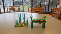 Two green LEGO garden scenes