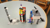LEGO rocket, command and control bunker, and rocket launch pad