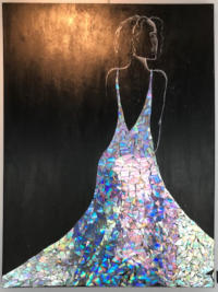 A woman in a sparkling dress made out of reflective materials.