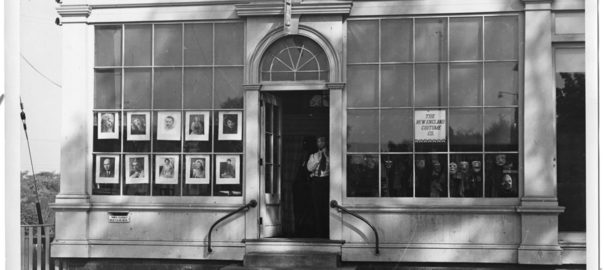 Ted Avery, wearing a mask, stands in the doorway to his costume shop and Ky Mortenson's photo studio.