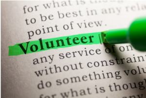 green highligher emphasizes volunteer in a page of text
